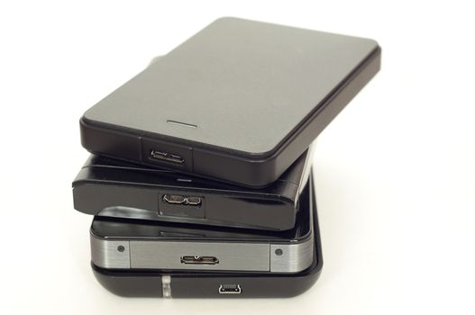 Pile of four external USB hard drives