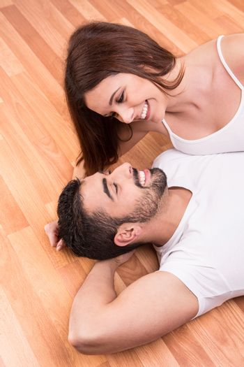 Love Couple at home relaxing on the floor