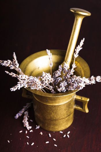 Dry lavender bunch in the copper mortar