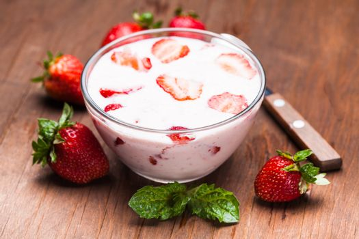 Strawberry yoghurt in a bowl on the  table