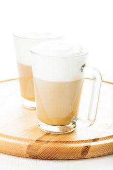 Coffee latte in glass mugs on the board
