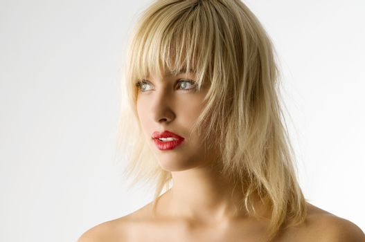 fashion portrait of blond girl with red lips