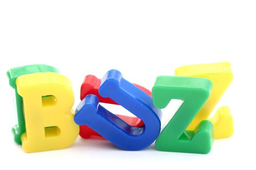 "Close-up of letters. ""Buzz"" word."
