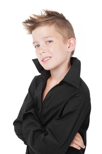 Young charming adorable boy with macho pose isolated on white background.