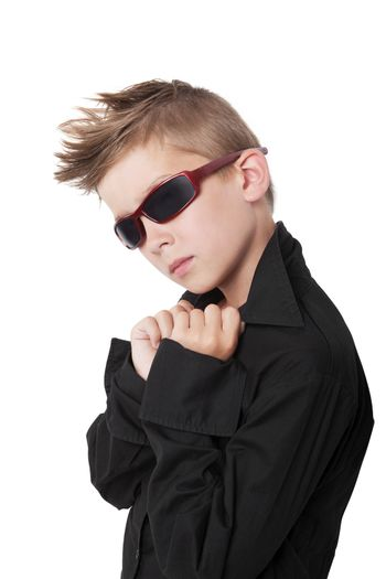Confident cool boy with black dress shirt and sunglasses isolated on white background.