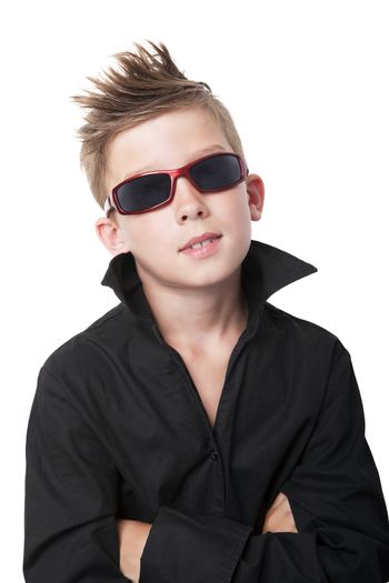 Confident charming young boy with black dress shirt and sunglasses isolated on white background.