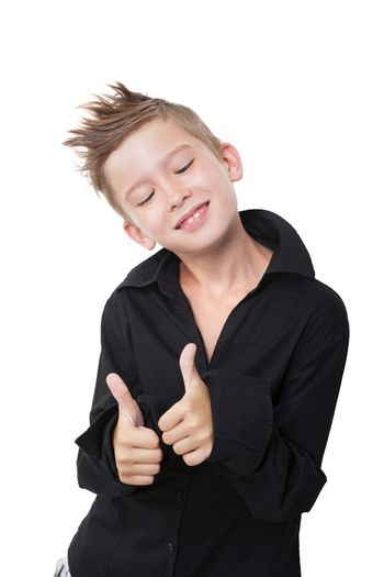 Charming boy with modern haircut showing thumbs up isolated on white background.