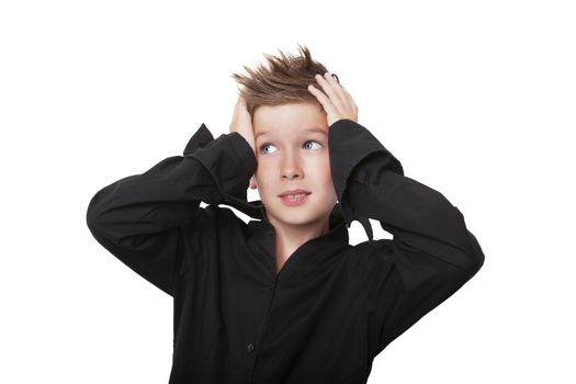 Charming expressive boy touching his head with both hands isolated on white background.