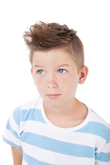 Portrait of young casual charming boy with cool haircut isolated on white background.