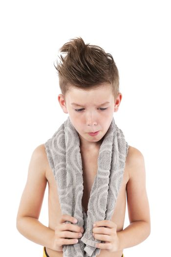 Boy with towel isolated on white background. Morning hygiene concept.