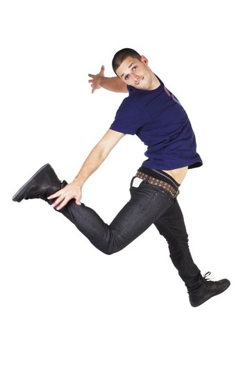 Young man in jeans and t shirt jumping in the air isolated on white background.