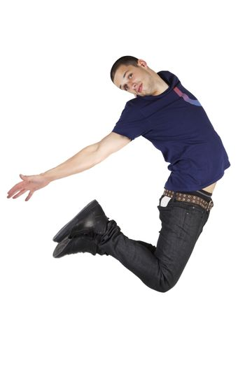 Young man in stylish casual clothing jumping in the air isolated on white background.