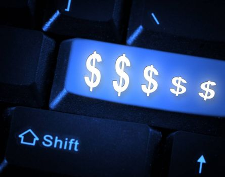 Close-up picture of a computer keyboard - blue key $$$