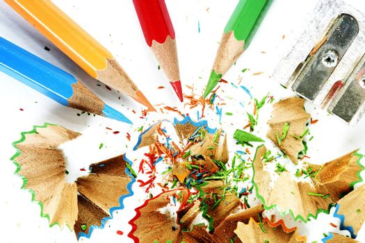 Sharpened pencil and wood shavings.