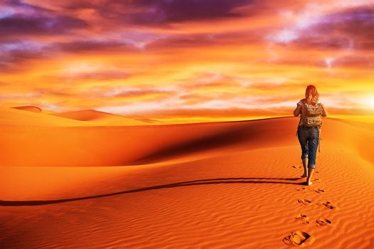 Woman traveling in the desert
