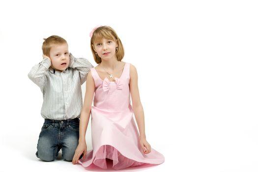 Studio portrait of siblings beautiful boy and girl