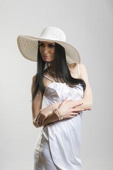 Pretty Caucasian woman in white dress