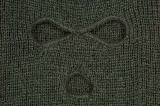 Green abstract background or texture, a balaclava mask.