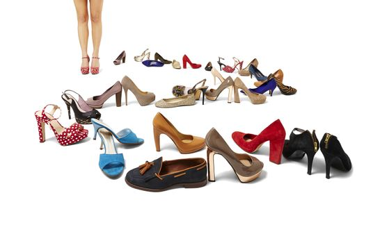 Female legs and huge selection of shoes