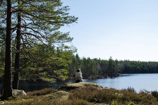 Woman watching at a lake