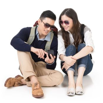 Asian young couple traveling and using mobile phone