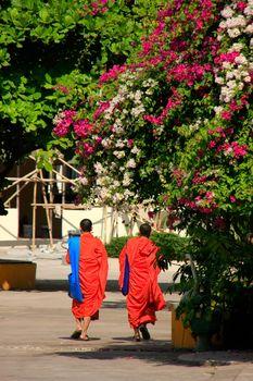 Two monks walking at Wat Si Saket, Vientiane, Laos