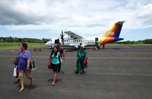 Passangers getting out of Pacific Sun airplane, Labasa airport,