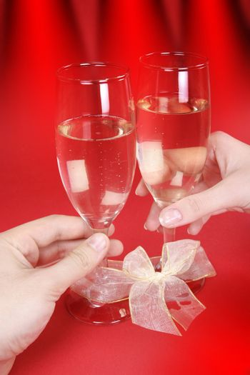 Couple celebrating valentine's day with champagne.