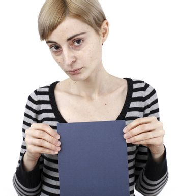 Young blonde woman holding a blank piece of paper.