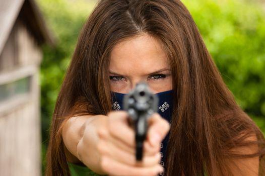 Female Bandit Points Snub Nose Revolver Handgun Weapon
