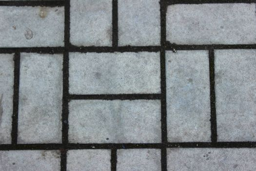 Rectangular paving slabs laid out in the form simmetrichnymh forms