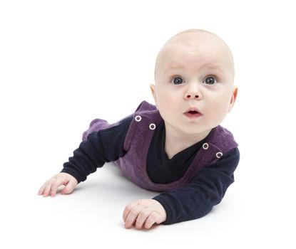 astonished baby on floor