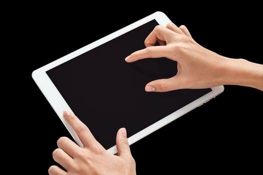 Fingers touching digital tablet screen