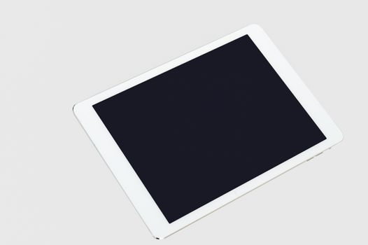 Tablet computer on grey background