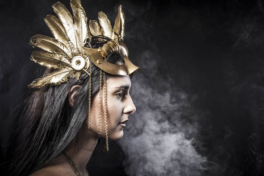 Sensual young woman with golden mask jewelry