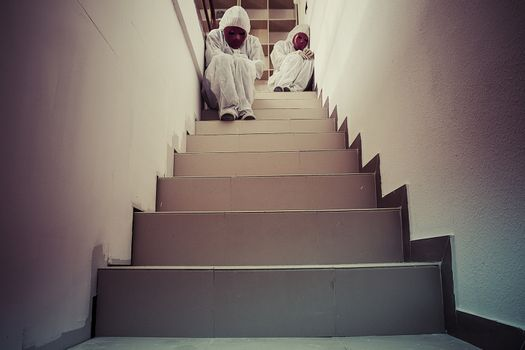 Stairs, Nightmare concept, man with white dress and red mask