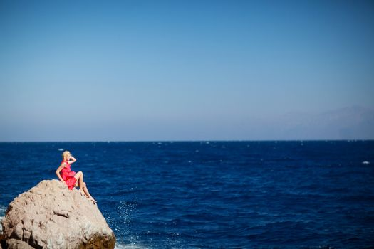girl on the rock in the sea