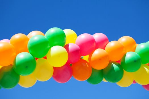 bright balloons and blue sky