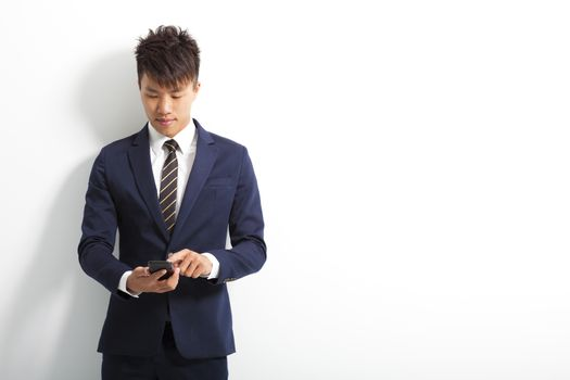 smiling young man touching smartphone