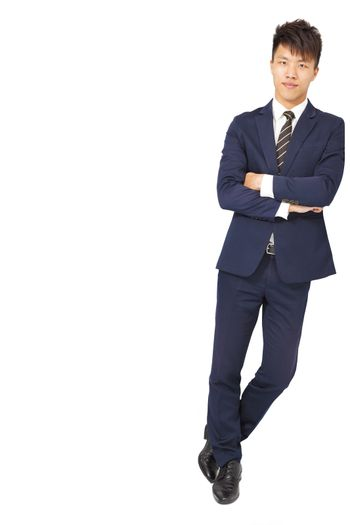 Full body portrait of young happy smiling business man