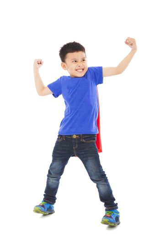 happy super kid hero imitate superman pose