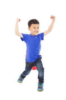 cute kid imitate superman pose and facial expression