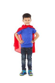 confident Superhero kid standing in studio