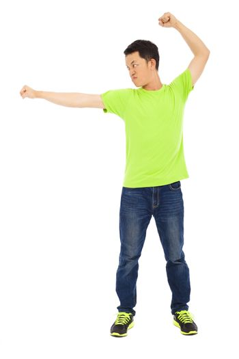 young man making a martial art pose
