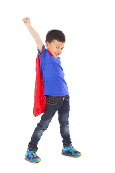 superhero kid make a funny facial expression