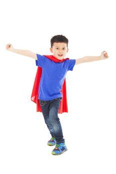 superhero kid standing in studio