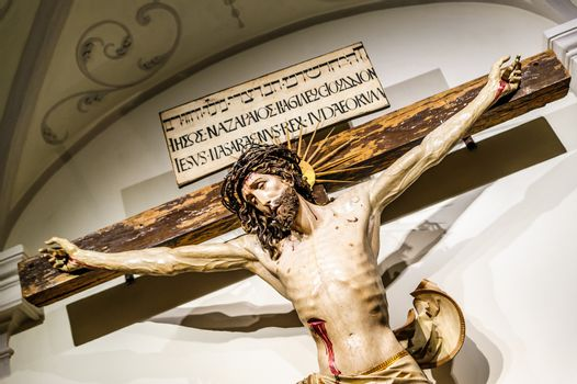 Jesus Christ crucifixion inside of an abbey