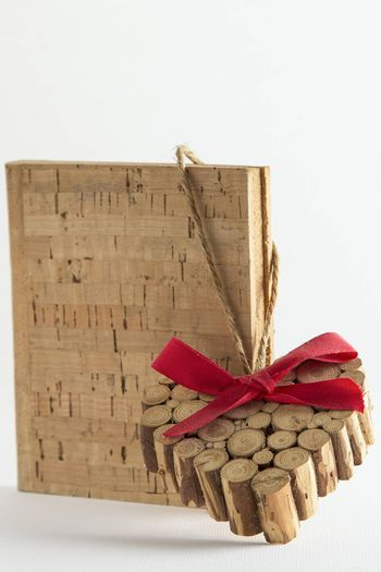Old Vintage red ribbon heart and cork book