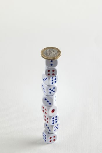 euro coin on dice stack