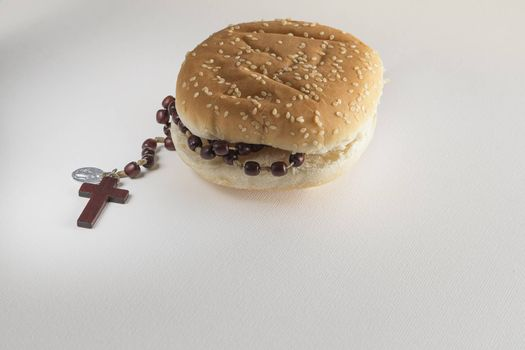 Fast food bread and Holy Rosary beads necklace